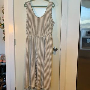 White jumpsuit with black, vertical stripes